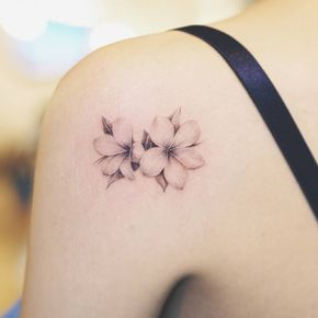 Plumeria tattoo on the left shoulder.