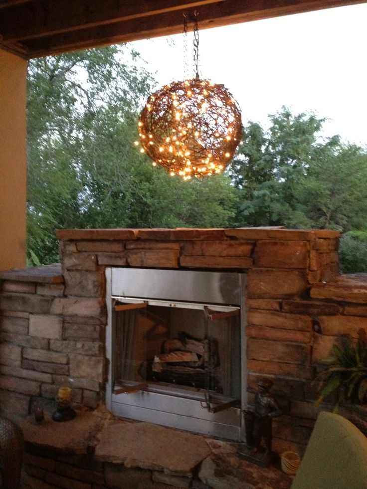 One ball of barbed wire + two strings of Christmas lights = A pretty cool outdoor chandelier. Buy string lights online at http://www.partylights.com/Mini-Lights.