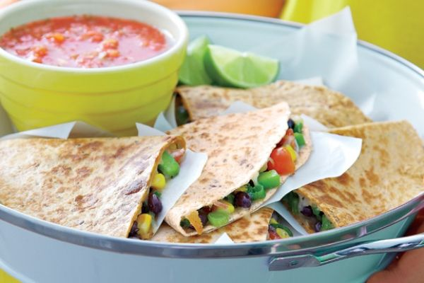 Crisp black bean and smoked cheese quesadillas are the ultimate quick dinner but also make a great party appetizer. You can just as easily make them on the grill as in a skillet. Just brush the outside with olive oil before grilling. Photography by Edward Pond.