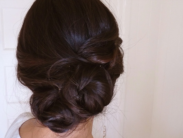 split hair into three... tie in sweeping knot and then twist hair in and around pin..?