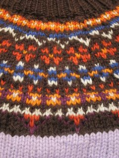 "Fimma is a cosy Icelandic sweater (""lopapeysa""). It is knit in the round from the bottom up."