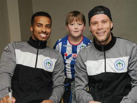 Photos from the Team Latics Christmas Party and Royal Albert Edward Infirmary Christmas visits for the Wigan Athletic players.