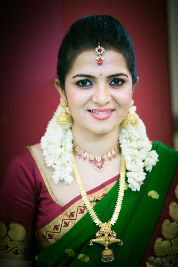 South Indian bride. Temple jewelry. Jhumkis.Red and green silk kanchipuram sari.Braid with fresh jasmine flowers. Tamil bride. Telugu bride. Kannada bride. Hindu bride.Malayalee bride.Kerala bride.South Indian wedding.Dhivyadarshini.