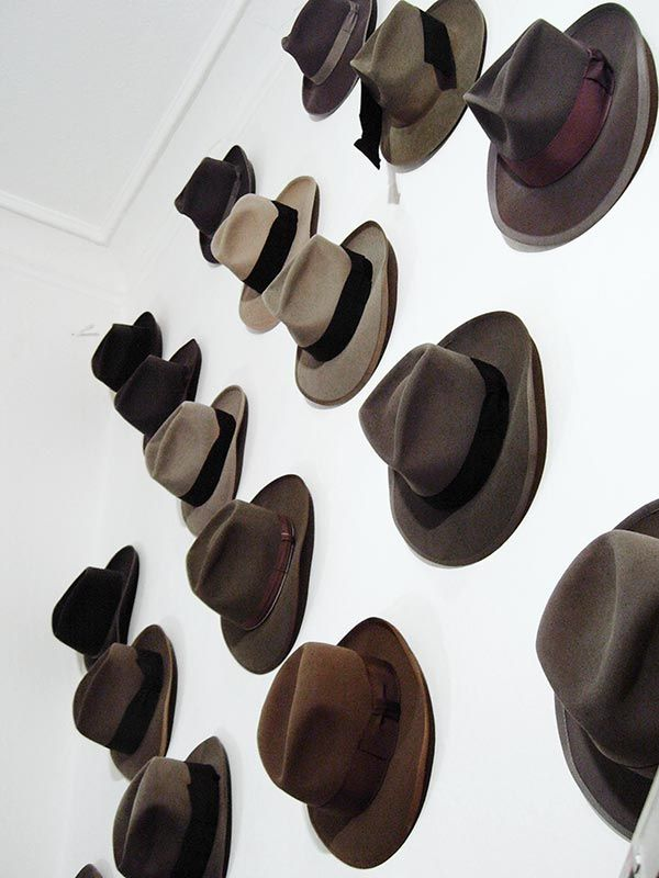 Cool men's hat wall display, using push-pins.