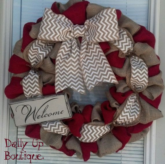 This is a cute wreath made of Natural Red and White Chevron Burlap. The wood WELCOME sign is painted cream and given a distressed look.  The sign