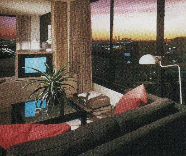 """black couch, red pillows, palm, tv static, white standing lamps, sunset   palmandlaser  From """"The International Collection of Interior Design"""" (1985)"""