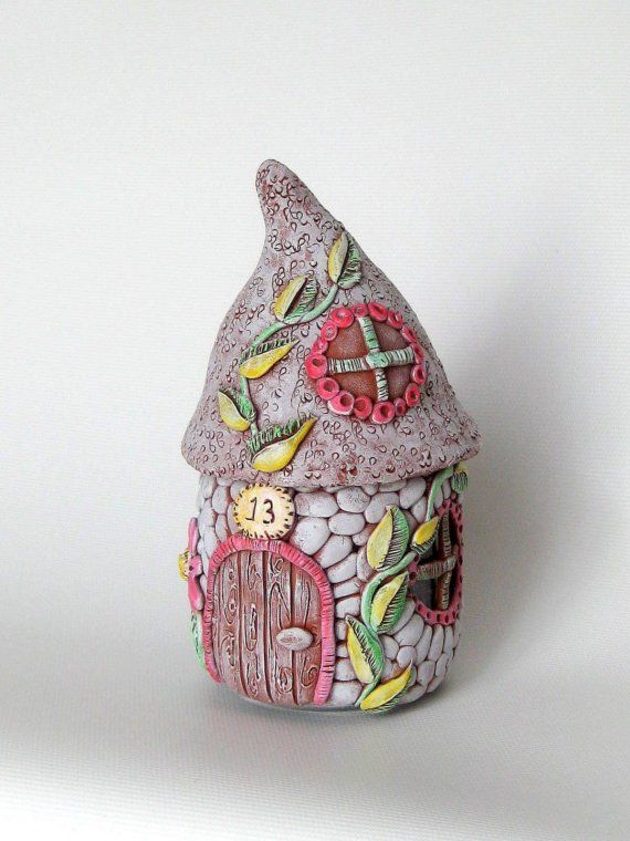 Polymer clay and jelly jars make adorable fairy houses.