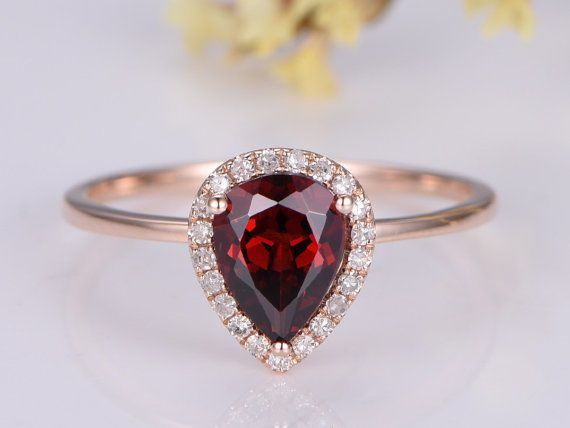 Never has a pear-shaped stone been quite as popular as it is now and we find the one on this example irresistible. This garnet engagement ring is very feminine with an extra dose of romance! | Gorgeous Garnet Engagement Rings