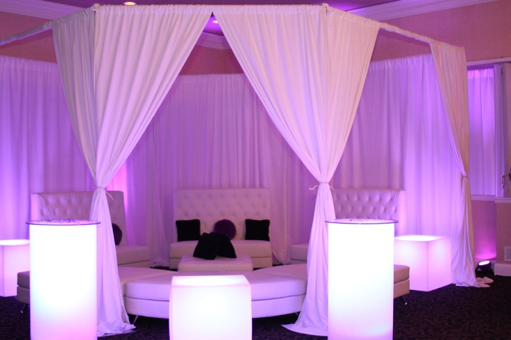 White lounge furniture with a cabana and pink uplighting is perfect for a Sweet 16, Bat Mitzvah or any special event!  By Picture Us Perfect www.PictureUsPerfect.com www.Facebook.com/PictureUsPerfectCorp