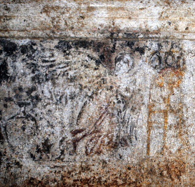 The flying figure, Nike (?) who is moving towards the tripod and krater, from the architrave found in the tomb of Amphipolis