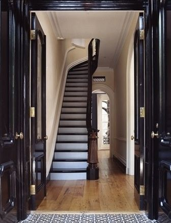 Italianate New York townhouse reno by Fairfax & Sammons - unbelievable high gloss black double door entry.