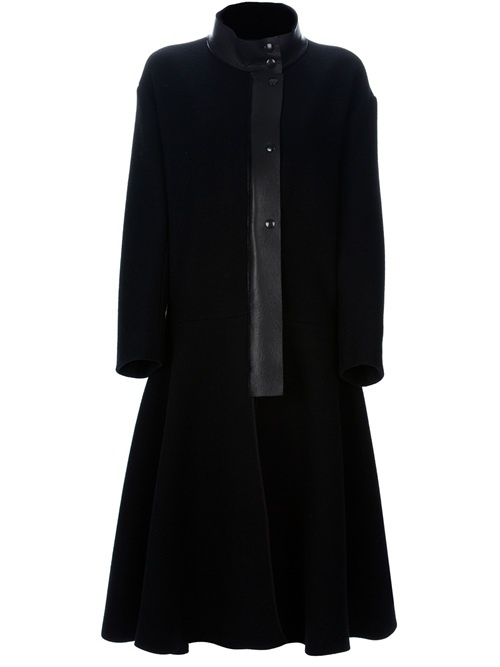 Black wool coat from Ter Et Bantine featuring a tonal high neck with a front button closure, a tonal front button closure, an oversized fit, an oversized flared design and long sleeves.