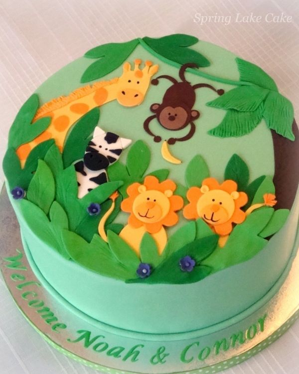 Two dimensional safari cake.  monkey, giraffe, lion and zebra