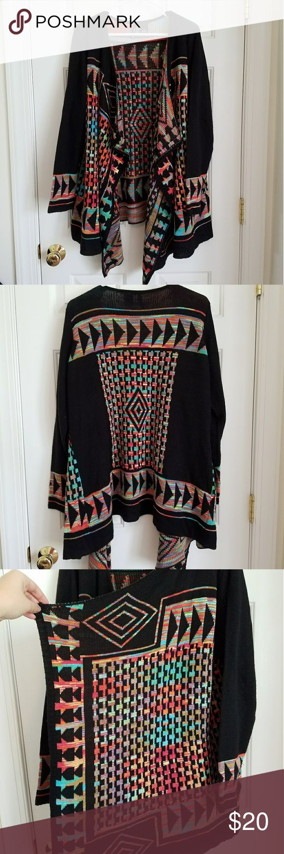 Vibrant Aztec Cardigan sz 1X Vibrant Aztec print cardigan by New Directions in size 1X, fits 16/18/20. Good used condition, light pilling at armpits. From a smoke free, cat friendly home. new directions Sweaters Cardigans