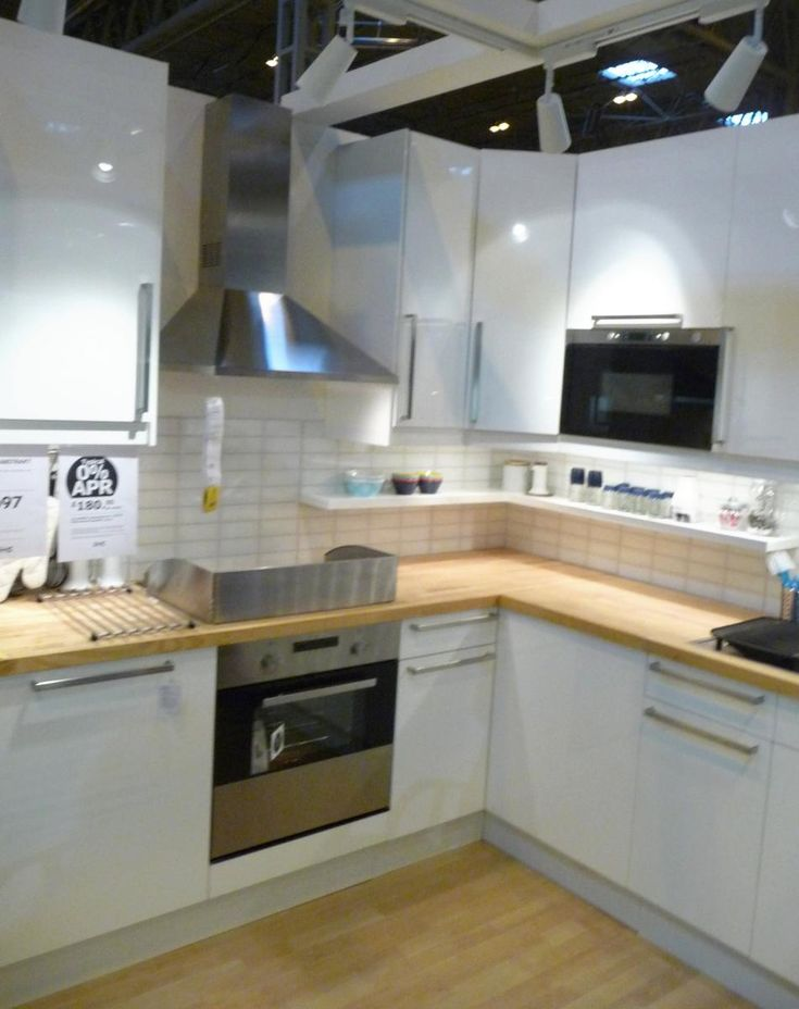 IKEA's Abstrakt high gloss white kitchen display at Grand Designs Live