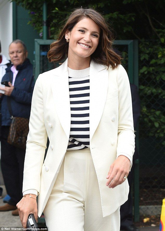 Glamorous as always: For her day out court side, Gemma opted for a jaunty twist on a classic summer staple - a white linen suit jacket with a nautical blue and white jumper - clearly forewarned about the weather