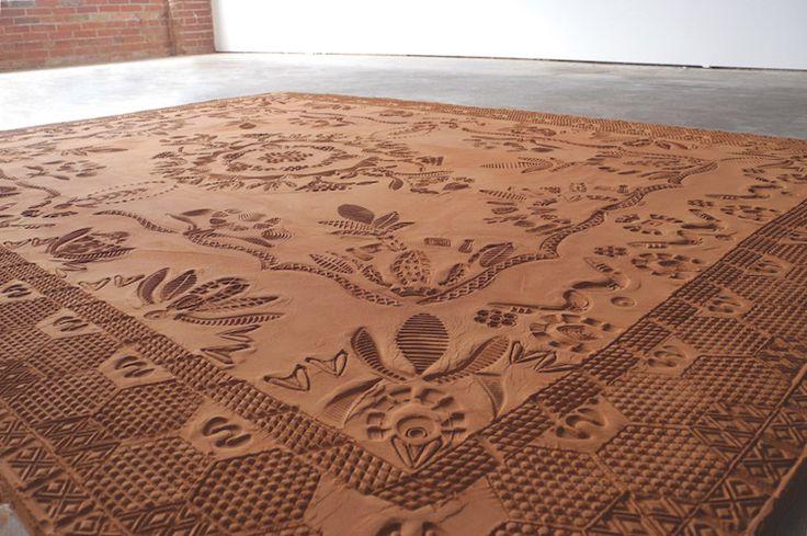 Artist Rena Detrixhe creates ephemeral patterned rugs from red dirt