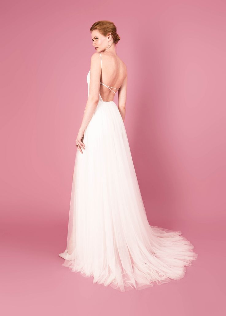 Modern wedding dress for the contemporary bride. Octavia dress - Muscat Bridal, Backless tulle gown with side slit.