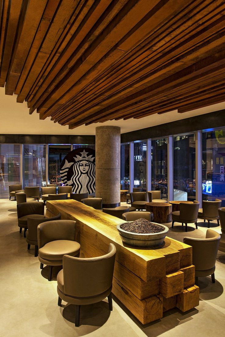 The ceiling-to-floor glass windows at the Taikoo Li Sanlitun Starbucks store in Beijing present a view of the site's courtyard, a meeting point of China's young and cosmopolitan people.