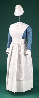Student nurse uniform, Western Hospital, Montreal 1917 - 1918 Medium: Cotton; dress printed with the monogram of the hospital: WHM Gift of Canadian Nurses Association Society of America,
