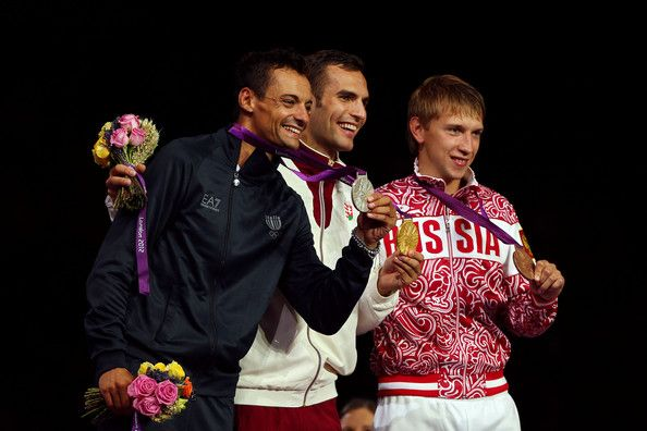 (L-R) Silver medalist Diego Occhiuzzi of Italy, gold medalist Aron Szilagyi of Hungary and bronze medalist Nikolay Kovalev of Russia pose on the podium during the medal ceremony for the Men's Sabre Individual on Day 2 of the London 2012 Olympic Games at ExCeL on July 29, 2012 in London, England.