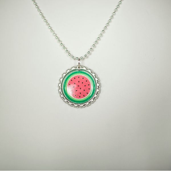 The perfect party favor for your watermelon party! This is a set of six watermelon necklaces, each made with a new flattened bottle cap. The bottle cap is smooth around the edges, making it safe for l