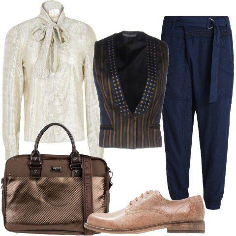 Pantalone leggero e morbido con cintura su camicia in lamè con fiocco sul collo. Gilet a righe con scollo profondo. Mocassino stringato e ampia borsa da lavoro.
