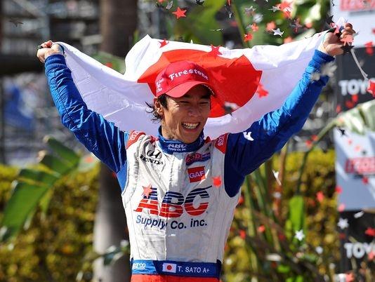 Takuma Sato waves a Japanese flag after winning the 2013 Toyota Grand Prix of Long Beach Sunday.