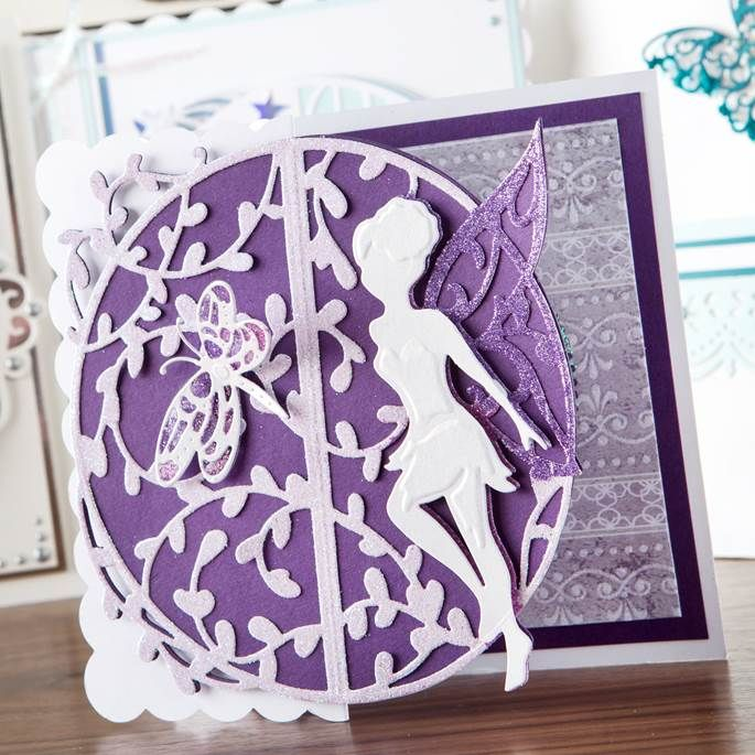 White and purple card made from the new Nuvo Range by Tonic Studios! Available to buy at Create and Craft - http://www.createandcraft.tv/SearchGridView.aspx?fh_location=//CreateAndCraft/en_GB/$s=nuvo&gs=nuvo