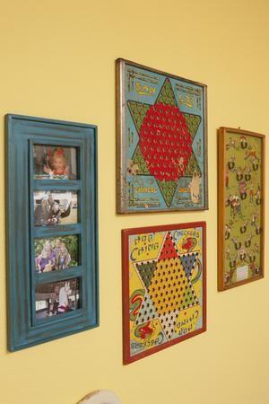 Vintage board games serve as great wall art. See more Junk Gypsy renovations: http://www.gactv.com/gac/shows_hjkgp/article/0,3561,GAC_45849_6067523_16,00.html