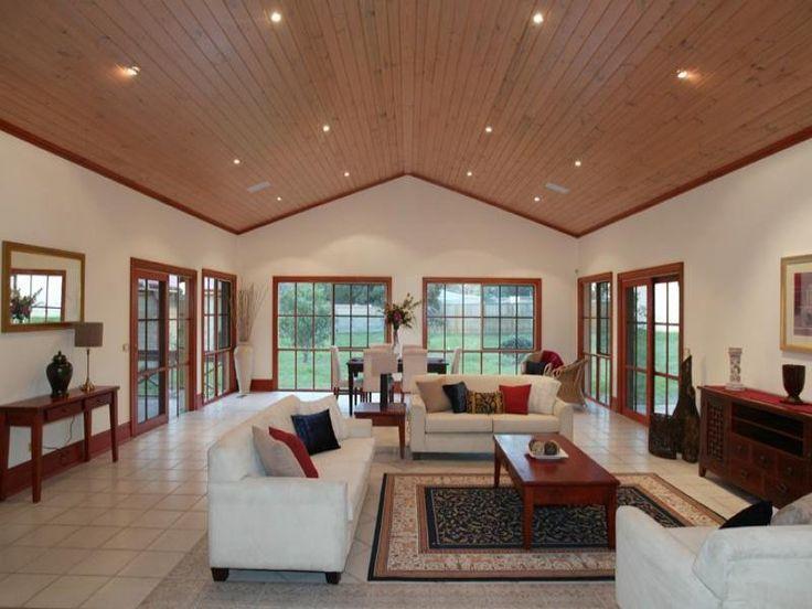 Modern elegant living room large space interior decorating for Vaulted living room decorating ideas