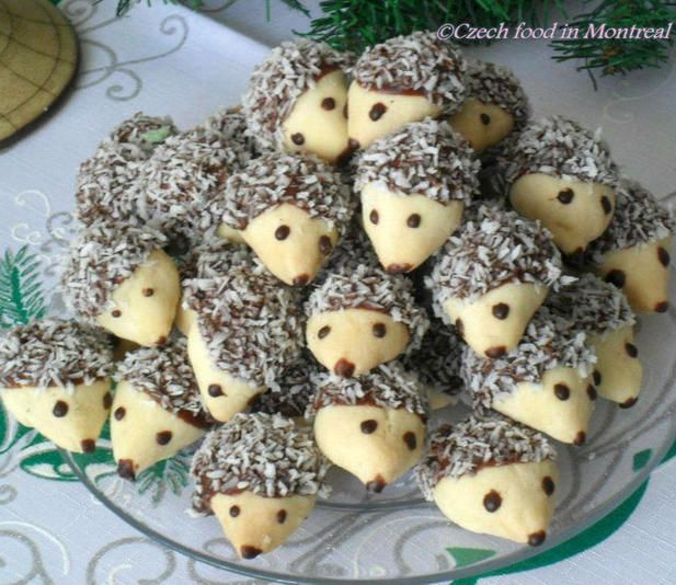 Hedgehog cookies stuffed with a walnut, topped with chocolate   coconut flakes