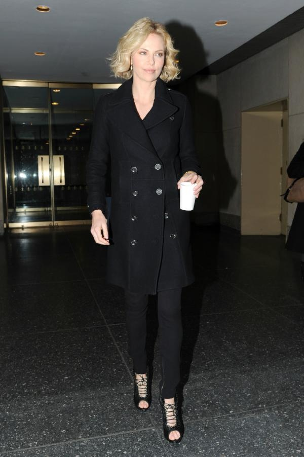 Charlize Theron wearing a Burberry trench coat