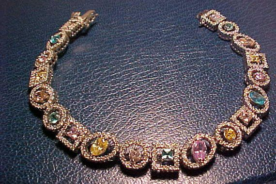 Well detailed bracelet. Fine facetted stones either CZ or Swarovski not sure which. Fancy bracelet marked 925 for Sterling. This bracelet is made to impress. Bracelet is 7 1/2 long. Has clasp and safety clasp. Weighs21 grams about .7 of an oz., of silver. FREE shipping in the United States Thank you for looking please stop by often.
