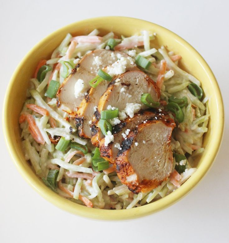 Instead of fatty coleslaw, mix up this lightened-up broccoli slaw salad recipe instead. Served with lean pr...
