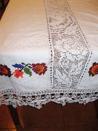 A superb 100 % hand woven cotton on hemp tablecloth with hand made lace from Transylvania . Available at www.greatblouses.com