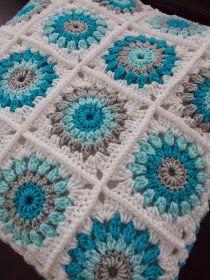 Color combo. Granny square free pattern here http://nittybits.blogspot.nl/2013/01/sunburst-granny-square-blanket-tutorial.html?m=1