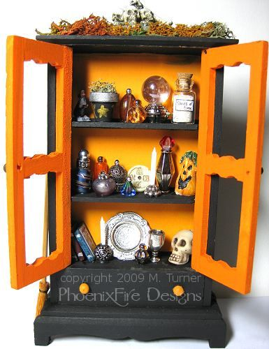 Spooky Hutch.  It's about as tall as a can of soda.  Made by phoenixfiredesigns.