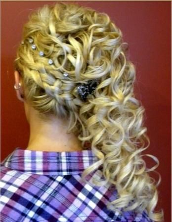 Curly, braided over the shoulder half-up prom hair with rhinestones