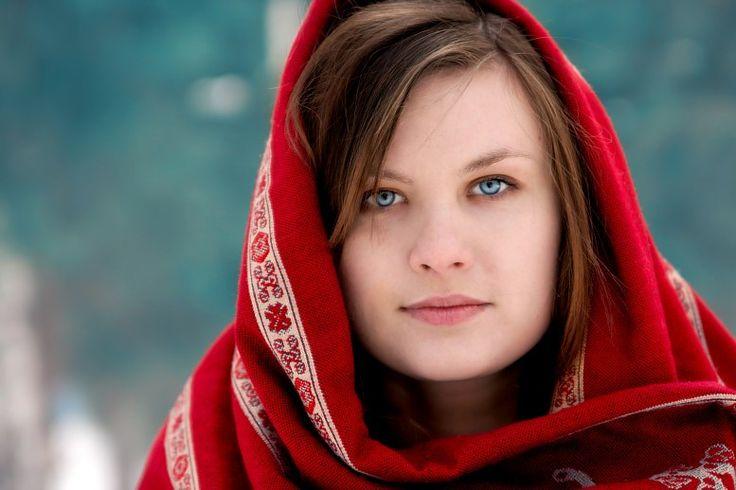 Russian women: A portrait of a beautiful Russian girl in a Russian kerchief