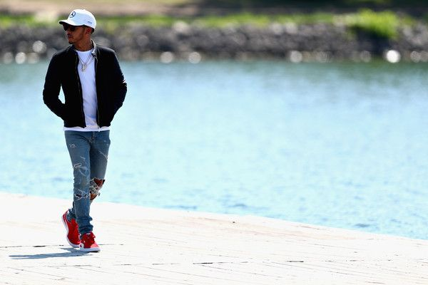 Lewis Hamilton Photos Photos - Lewis Hamilton of Great Britain and Mercedes GP walks into the paddockduring previews for the Canadian Formula One Grand Prix at Circuit Gilles Villeneuve on June 8, 2017 in Montreal, Canada. - Canadian F1 Grand Prix - Previews