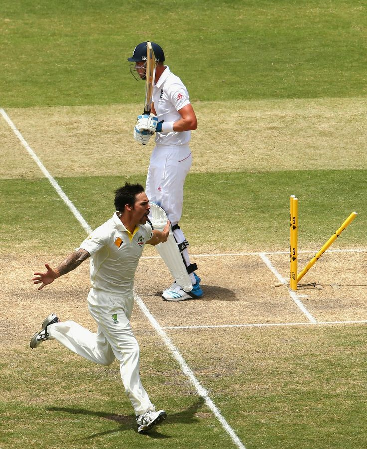 Stuart Broad can't argue with England's nemesis Mitchell Johnson when the wood's knocked over... (Source: Cricinfo Photo: Getty Images)