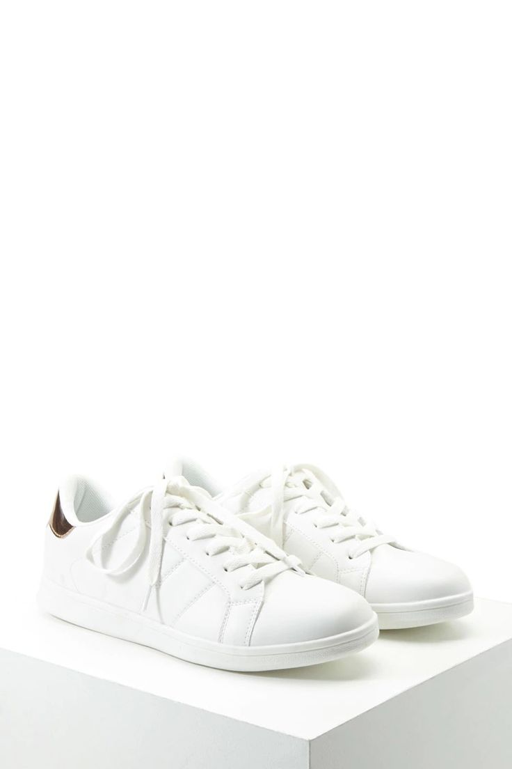 These faux leather sneakers features a lace-up closure, round toe, and a metallic faux leather accent at the ankle.