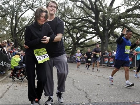 Four months ago, Monique Koll was in a hospital bed, wondering if she'd ever walk again. She'd suffered a severe spinal cord injury and doctors weren't sure she'd survive. On Sunday, Koll was crossing the finish line of the Rock 'N' Roll New Orleans Half Marathon with the help of her boyfriend who has been with her every step of the way. http://on.today.com/15KSvzO
