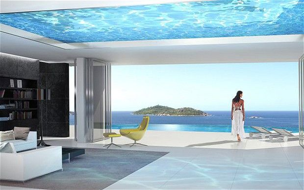Luxury villa on Felicite Island, the Seychelles. A glass-bottomed swimming pool acts as the roof of the reception room. Photo via telegraph.co.uk.