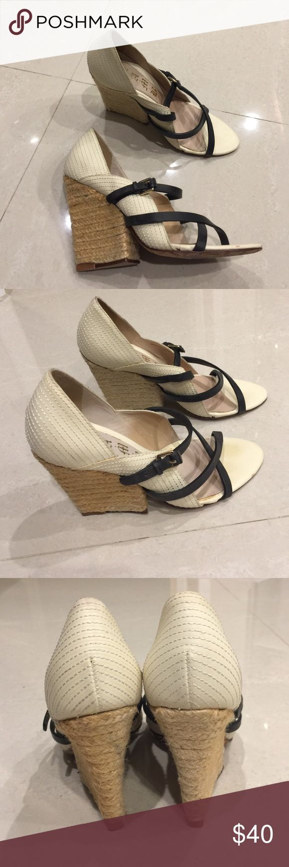 Lamb leather and rope heel shoes size 5 1/2 Sexy yet interesting rope heel shoes with white stitched and black leather. Size 5 1/2 in great condition as I only wore them once for about 1 hour at the most. They definitely need a loving closing, as they are a great pair or shoes. Lamb Shoes Heels