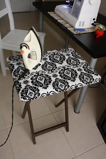 Wonderful little ironing board for sewing made from a TV tray