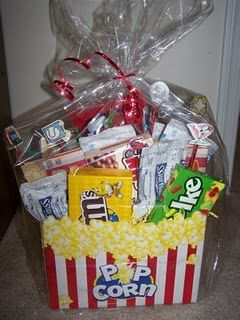 One of my favorite gift baskets to give to couples or families.  Movie gift basket with treats!