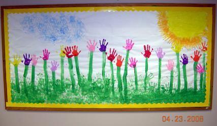 Spring Bulletin Board Idea.                           Handprint Spring Mural.                              Paint yellow sun in corner. Add hand print rays. Handprint light blue clouds in sky. Handprint green grass. Paint tall stems with brush. Add handprint flowers.