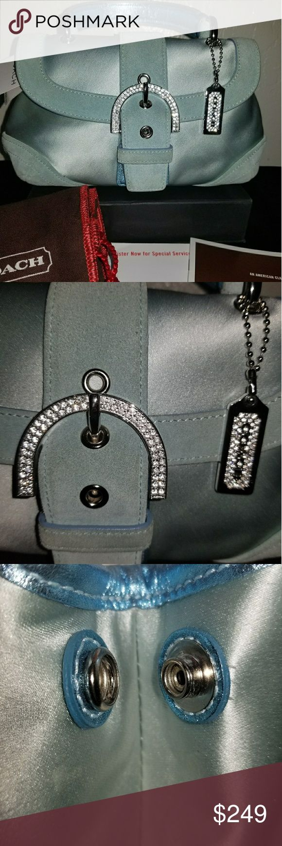 🎈⚠️NWT! RARE SATIN COACH SATCHEL 🌟Very RARE Vintage COACH Baby Blue Satin Satchel with Suede trim, Silver hardware and Swarovski Crystal embellishment. It Is Brand-new with the tags 100% Authentic and comes with dust cover. 💲RETAIL $298  🎀GET A FREE AUTHENTIC COACH SILVER BANGLE BRACELET WHEN YOU BUY IT NOW FOR ONLY $249! Coach Bags Satchels